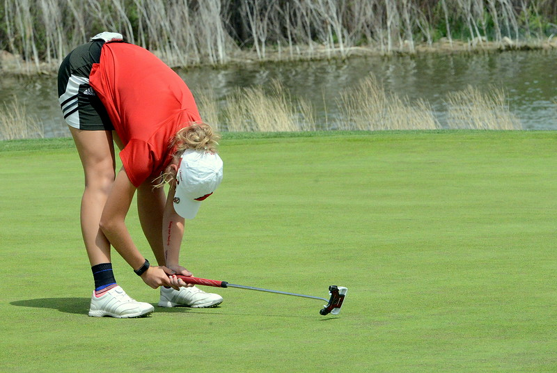 Loveland's Lauren Lehigh reacts to her putt on No. 18 sliding by the hole, leaving her in a three-way tie for the lead after the first round of the 4A state girls golf tournament Monday at Country Club of Colorado in Colorado Springs. Lehigh, the defending champion, shot a 7-over 78. (Mike Brohard/Loveland Reporter-Herald)