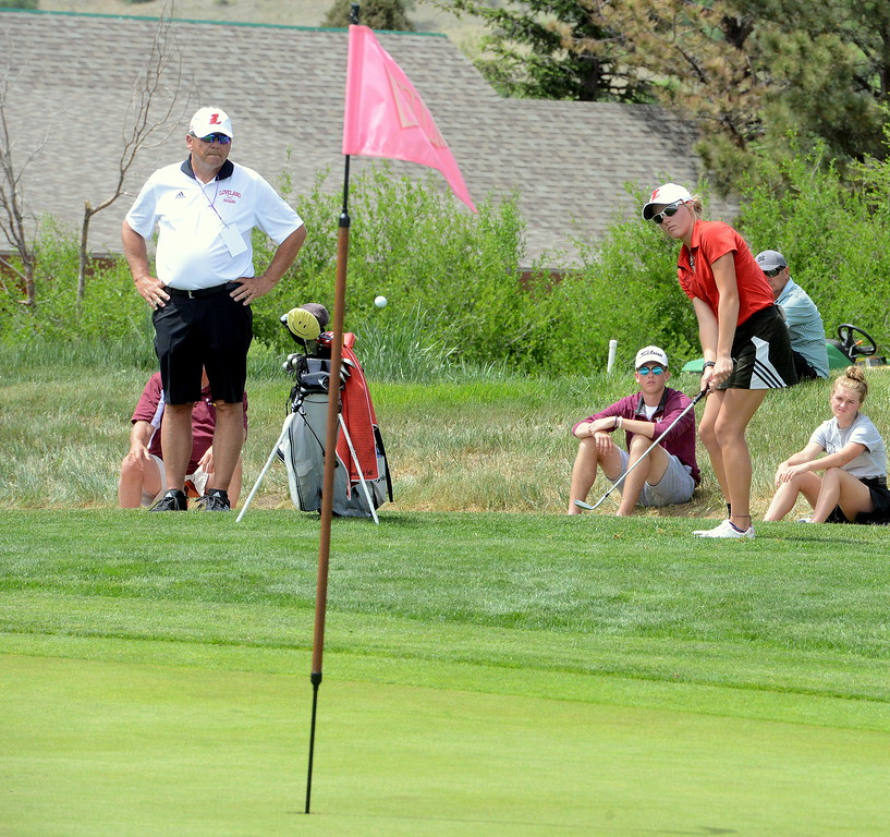 Loveland coach Bill Stephens watches as Lauren Lehigh chip on to the green during the first round of the 4A state girls golf tournament Monday at Country Club of Colorado in Colorado Springs (Mike Brohard/Loveland Reporter-Herald)