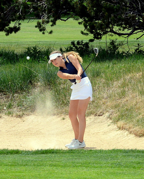Mountain View's Renee Demaree chips out of a bunker during the first round of the 4A state girls golf tournament Monday at Country Club of Colorado in Colorado Springs (Mike Brohard/Loveland Reporter-Herald)
