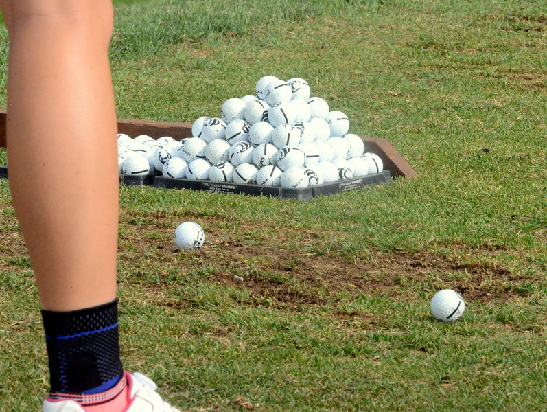 Players at the 4A state girls golf tournament had plenty of practice balls to hit prior to Monday's first round of play at the Country Club of Colorado in Colorado Springs. (Mike Brohard/Loveland Reporter-Herald)