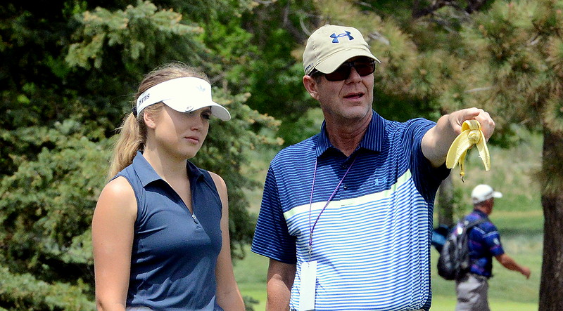 Mountain View's Renee Demaree listens to assistant coach John Perry during the first round of the 4A state girls golf tournament Monday at Country Club of Colorado in Colorado Springs (Mike Brohard/Loveland Reporter-Herald)