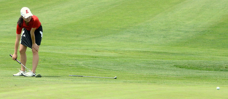 Casey Bradley of Lovland reacts to her putt during the first round of the 4A state girls golf tournament Monday at Country Club of Colorado in Colorado Springs (Mike Brohard/Loveland Reporter-Herald)