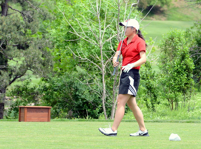 Loveland's Casey Bradley watches her drive on No. 8 during the first round of the 4A state girls golf tournament Monday at Country Club of Colorado in Colorado Springs (Mike Brohard/Loveland Reporter-Herald)