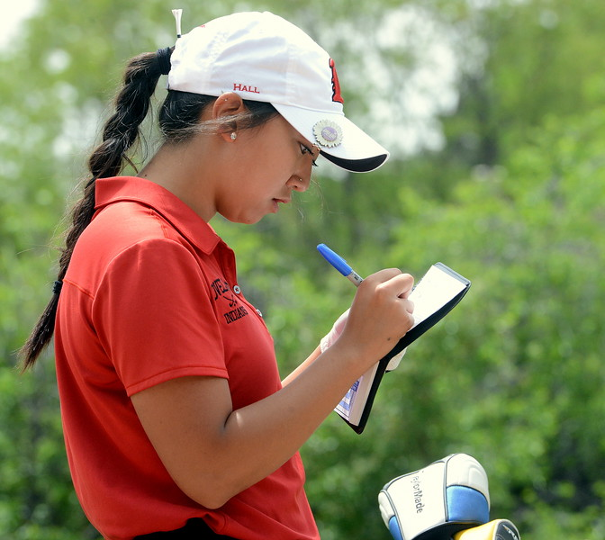 Natalee Hall marks down her score during the first round of the 4A state girls golf tournament Monday at Country Club of Colorado in Colorado Springs (Mike Brohard/Loveland Reporter-Herald)