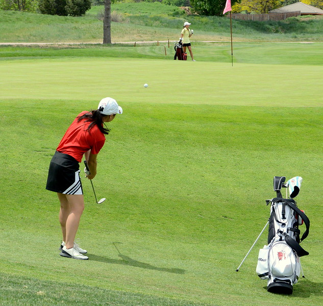 Loveland's Casey Bradley chips onto the green during the first round of the 4A state girls golf tournament Monday at Country Club of Colorado in Colorado Springs (Mike Brohard/Loveland Reporter-Herald)