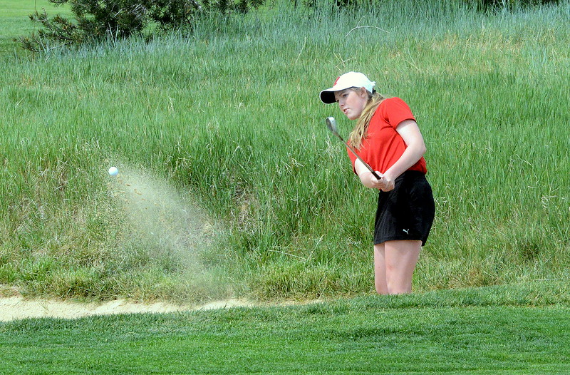 Loveland's Taylor Bandemer chips out of the sand during the first round of the 4A state girls golf tournament Monday at Country Club of Colorado in Colorado Springs (Mike Brohard/Loveland Reporter-Herald)
