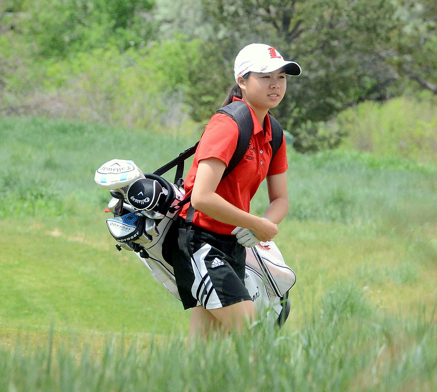 Loveland's Casey Bradley works her way to the next hole during the first round of the 4A state girls golf tournament Monday at Country Club of Colorado in Colorado Springs (Mike Brohard/Loveland Reporter-Herald)