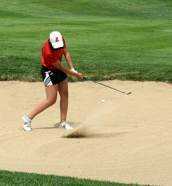Loveland's Natalee Hall chips out of a green-side bunker during the first round of the 4A state girls golf tournament Monday at Country Club of Colorado in Colorado Springs (Mike Brohard/Loveland Reporter-Herald)