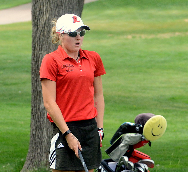 Loveland's Lauren Lehigh follows the advice on her right wrist and breathes as she looks down a tough lie on a slope during the first round of the 4A state girls golf tournament Monday at Country Club of Colorado in Colorado Springs (Mike Brohard/Loveland Reporter-Herald)
