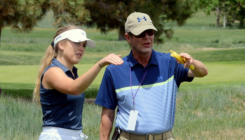 Mountain View's Renee Demaree and assistant coach Joe Perry discuss her approach to a chip during the first round of the 4A state girls golf tournament Monday at Country Club of Colorado in Colorado Springs (Mike Brohard/Loveland Reporter-Herald)