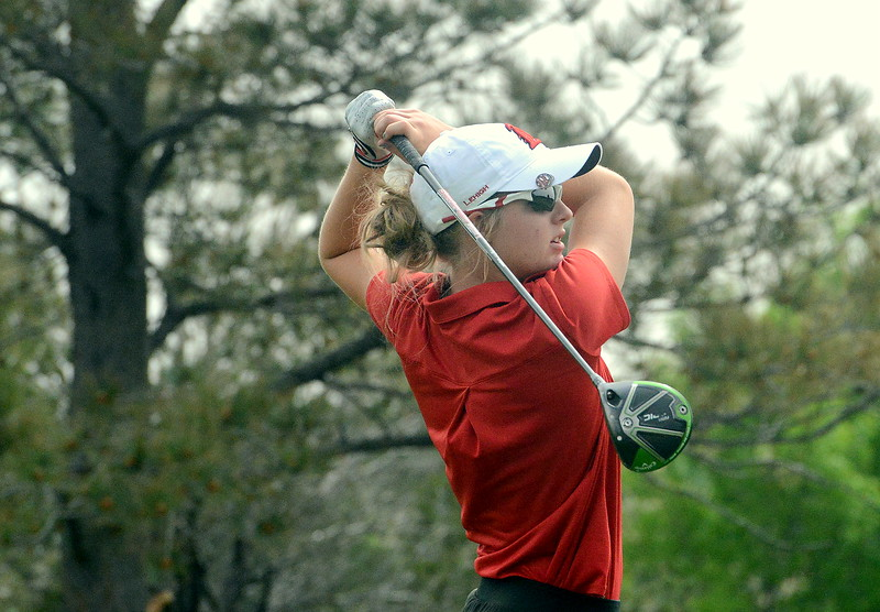 Lauren Lehigh of Loveland watches her drive on the fourth hole during the first round of the 4A state girls golf tournament Monday at Country Club of Colorado in Colorado Springs (Mike Brohard/Loveland Reporter-Herald)