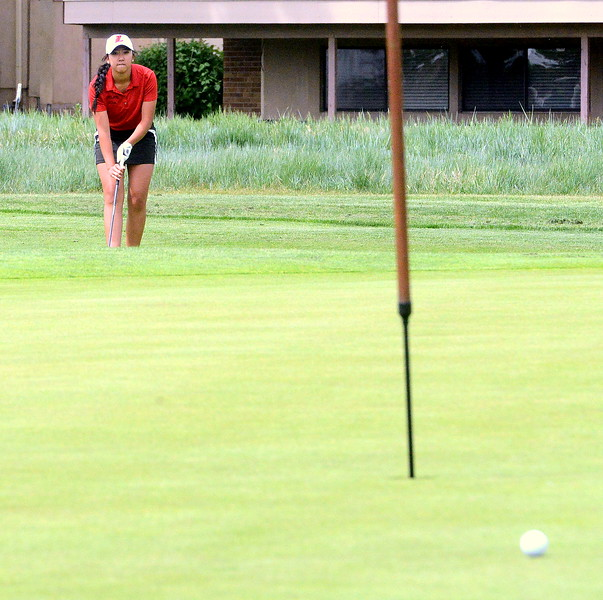 Loveland's Natalee Hall watches the roll of her chip during the first round of the 4A state girls golf tournament Monday at Country Club of Colorado in Colorado Springs (Mike Brohard/Loveland Reporter-Herald)