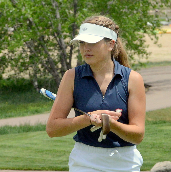 Mountain View's Renee Demaree takes off her glove as she prepares to putt during the first round of the 4A state girls golf tournament Monday at Country Club of Colorado in Colorado Springs (Mike Brohard/Loveland Reporter-Herald)