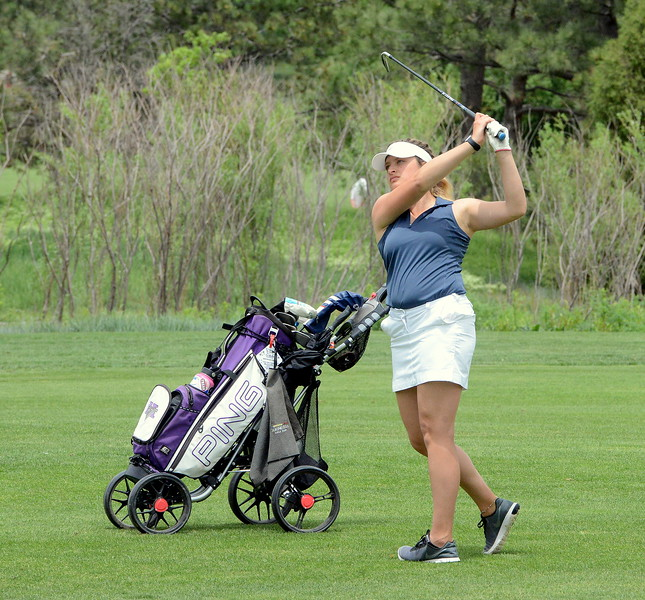 Mountain View's Camryn Polansky watches the flight of her fairway iron during the first round of the 4A state girls golf tournament Monday at Country Club of Colorado in Colorado Springs (Mike Brohard/Loveland Reporter-Herald)