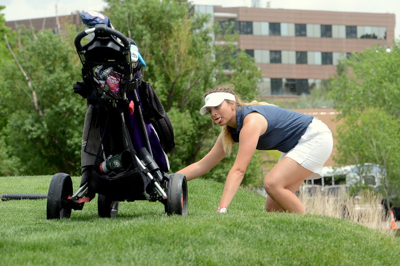 Mountain View's Camryn Polansky sticks out her tongue as the climb out of the green-side bunker on No. 18 was tougher than expected during the first round of the 4A state girls golf tournament Monday at Country Club of Colorado in Colorado Springs (Mike Brohard/Loveland Reporter-Herald)