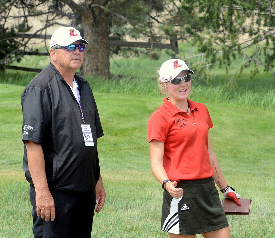 Lauren Lehigh of Loveland expresses some frustration with her round with coach Bill Stephens during the first round of the 4A state girls golf tournament Monday at Country Club of Colorado in Colorado Springs (Mike Brohard/Loveland Reporter-Herald)