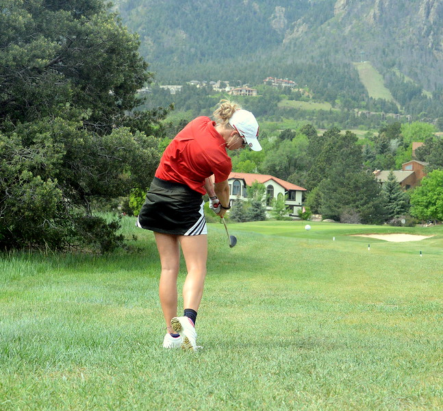 Loveland's Lauren Lehigh hits an iron from the rough during the first round of the 4A state girls golf tournament Monday at Country Club of Colorado in Colorado Springs (Mike Brohard/Loveland Reporter-Herald)