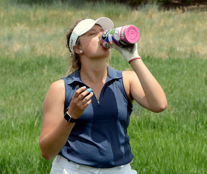 Mountain View's Camryn Polansky takes a drink of water as temperatures hit the upper 70s during the first round of the 4A state girls golf tournament Monday at Country Club of Colorado in Colorado Springs (Mike Brohard/Loveland Reporter-Herald)