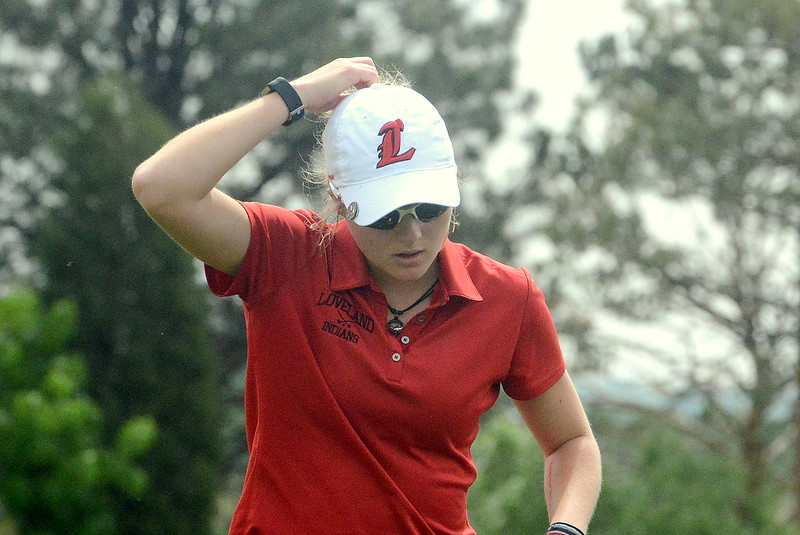 Lovland's Lauren Lehigh pulls a tee out of her ponytail as she gets set to drive during the first round of the 4A state girls golf tournament Monday at Country Club of Colorado in Colorado Springs (Mike Brohard/Loveland Reporter-Herald)