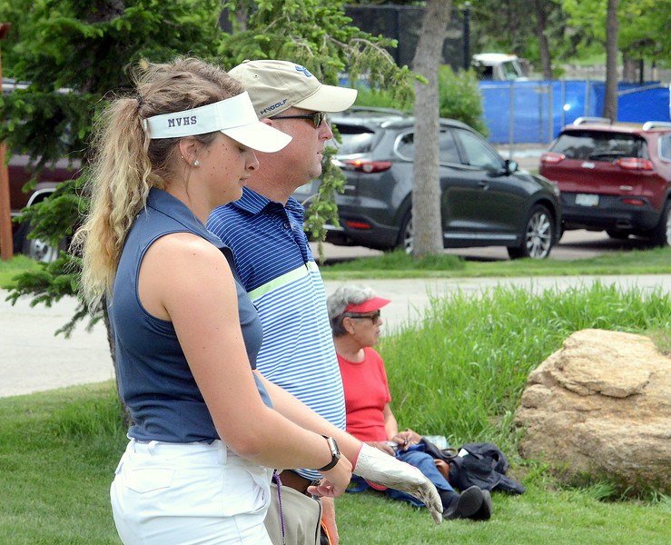 Mountain View's Camryn Polansky talks with coach Dave Hunn as she comes to the first tee box during the first round of the 4A state girls golf tournament Monday at Country Club of Colorado in Colorado Springs (Mike Brohard/Loveland Reporter-Herald)