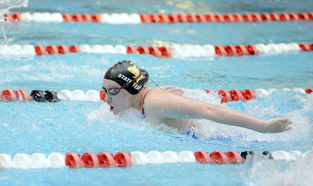 . Thompson Valley\'s Sophie Kubik attack the final 25 of the 100-yard butterfly during Friday\'s preliminaries of the 4A state girls swim meet at Veterans Memorial Aquatic Center. Kubik finished 11th in a time of 1:00.93, one of two consolation finals swims she will have on Saturday.