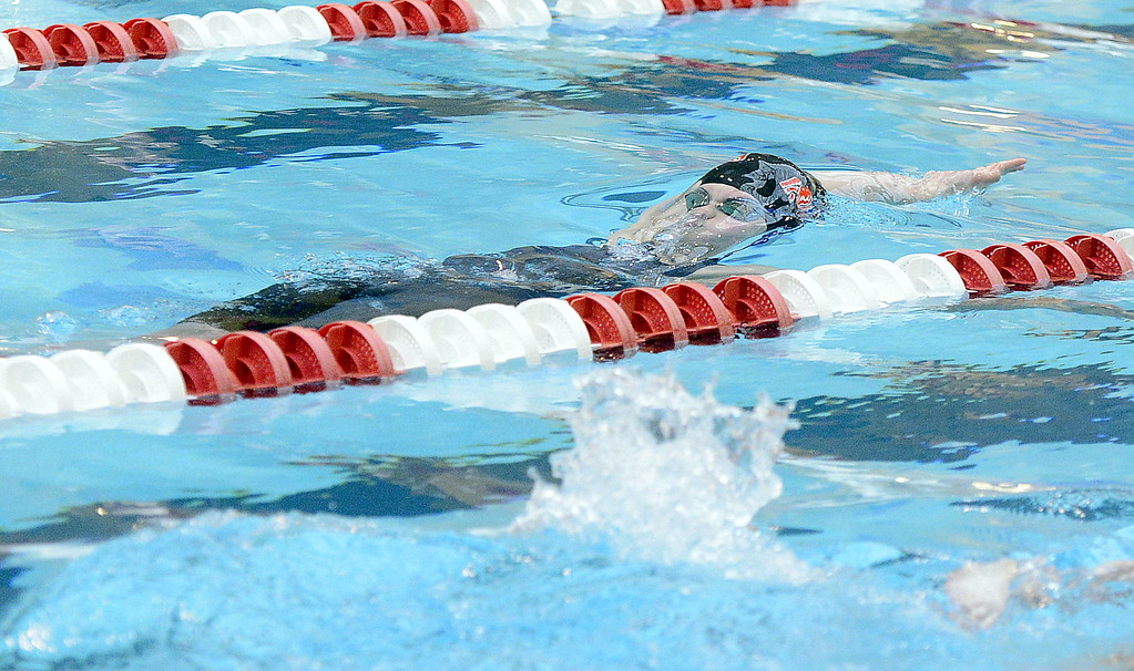 . Loveland\'s  Josie Brohard emerges from the start of the 100-yard backstroke during Friday\'s preliminaries of the 4A state girls swim meet at Veterans Memorial Aquatic Center. The junior jumped 10 spots with a time of 59.40 to finish fifth and make the championship finals in the event.