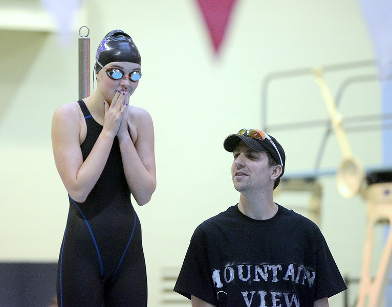Mountain View coach Jeff Collins talks to Abby O'Donnell prior to warmups for the 4A girls state swim meet preliminaries Friday at Veterans Memorial Aquatic Center.
