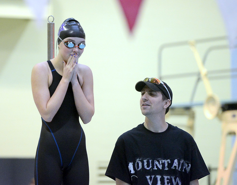 . Mountain View coach Jeff Collins talks to Abby O\'Donnell prior to warmups for the 4A girls state swim meet preliminaries Friday at Veterans Memorial Aquatic Center.