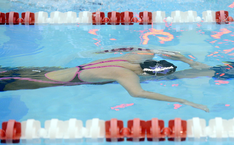 Mountain View's Sophie Busse is about to break the surface at the start of the 200-yard individual medley during the 4A girls state swim meet preliminaries Friday at Veterans Memorial Aquatic Center.