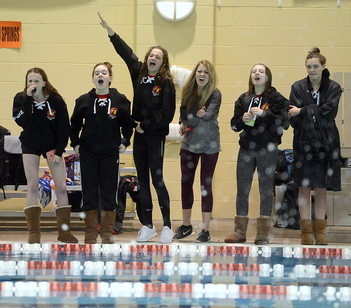 Loveland coach Sarah Vlakovitch and members of the Indians' team cheer on Thompson Valley's Emma McKalko during a 200-yard freestyle swim-off at the conclusion of the 4A girls state swim meet preliminaries Friday at Veterans Memorial Aquatic Center. McKalko won to become the second alternate for the finals.