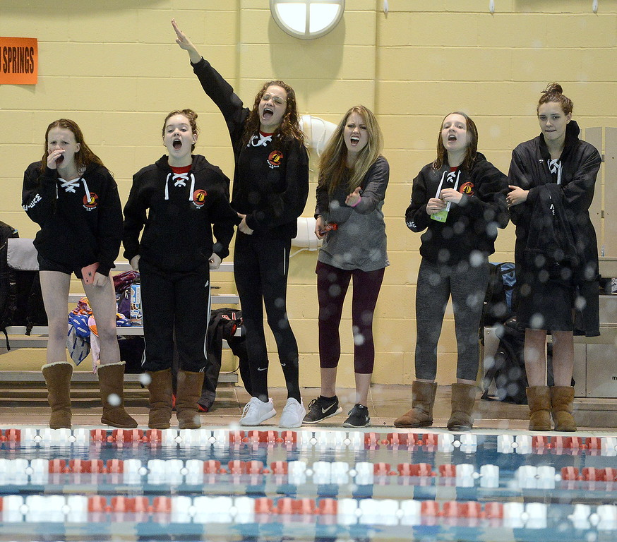 . Loveland coach Sarah Vlakovitch and members of the Indians\' team cheer on Thompson Valley\'s Emma McKalko during a 200-yard freestyle swim-off at the conclusion of the 4A girls state swim meet preliminaries Friday at Veterans Memorial Aquatic Center. McKalko won to become the second alternate for the finals.