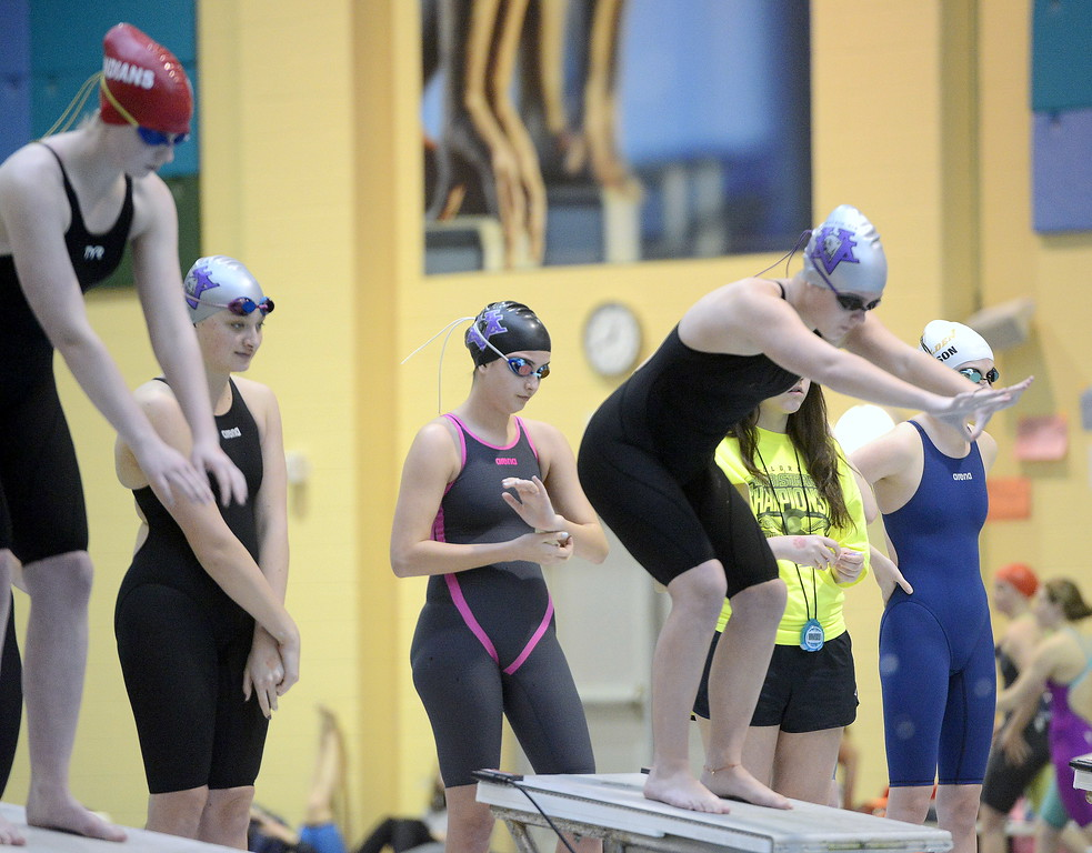 . Mountain View\'s Lily Busse is ready to start her leg of the 200-yard freestyle relay as teammates Camryn Polansky (back left) and Sophie Busse (middle) look on during the 4A girls state swim meet preliminaries Friday at Veterans Memorial Aquatic Center.