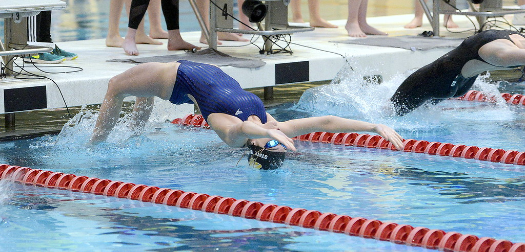 . Thompson Valley\'s Jamie Dellwardt comes off the blocks for the start of the 200-yard medley relay during the 4A girls state swim meet preliminaries Friday at Veterans Memorial Aquatic Center.