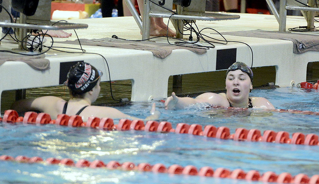. Mountain View\'s Grace Peterson, right, congratulates Loveland\'s Ella Doerr at the conclusion of their heat of the 100-yard freestyle during the 4A girls state swim meet preliminaries Friday at Veterans Memorial Aquatic Center.