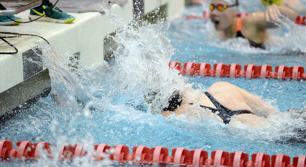 . Thompson Valley\'s Emily Fulp touches the wall at the end of the 50-yard freestyle during the 4A girls state swim meet preliminaries Friday at Veterans Memorial Aquatic Center.