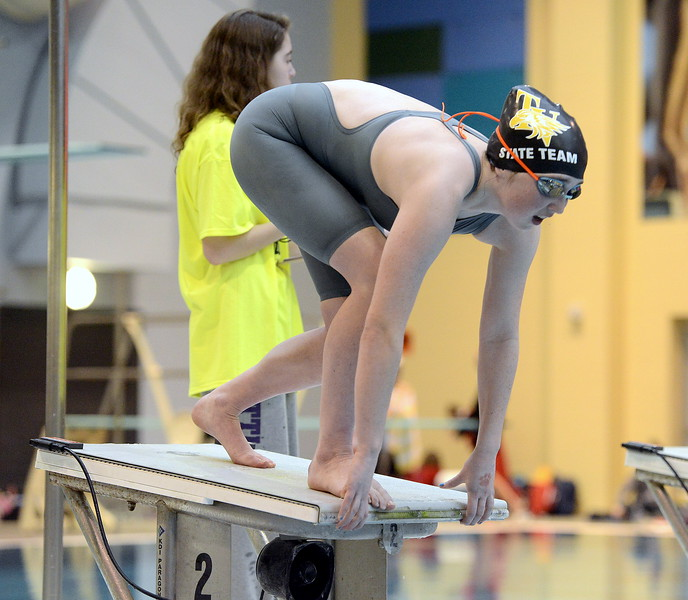 Arden McCauley of Thompson Valley steadies herself at the start of the 50-yard freestyle during the 4A girls state swim meet preliminaries Friday at Veterans Memorial Aquatic Center.