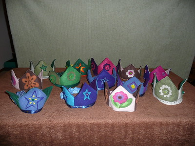 Felt Crowns - $7 or two for $10 - Please review the individual photos and select a crown by number.  They are made with a covered elastic back so the sizing is pretty flexible, but we do have them divided into small (young child), medium (older child), and large (adult) sizes.