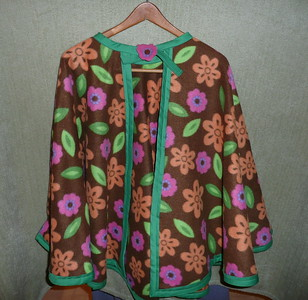#13 - Brown with Pink/Green/Orange flower design - Green trim - $15 or two for $25  (All capes are fleece and have velcro closure at the neck)