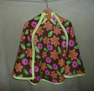 #7 Brown with Orange/Pink/Green flower design - $15 or two for $25  (All capes are fleece and have velcro closure at the neck)