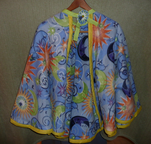 """#11 - Blue with Orange and Green Sun/Moon design - yellow/green trim - This cape is the larger cloak style - measures 30"""" from neck to hem - $15 or two for $25  (All capes are fleece and have velcro closure at the neck"""