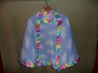 #8 - Blue cloud design with Rainbow ribbon trim - $15 or two for $25  (All capes are fleece and have velcro closure at the neck)