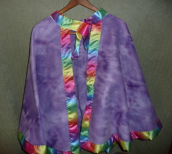 #12 - Purple tie-dye with Rainbow ribbon trim. - $15 or two for $25  (All capes are fleece and have velcro closure at the neck)