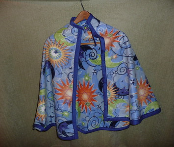 #5 - Blue, Orange and Green sun and moon print - $15 or two for $25  (All capes are fleece and have velcro closure at the neck)