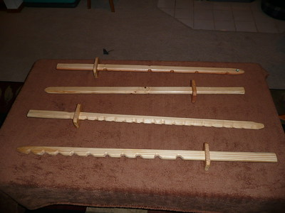 Wooden swords - These measure approximate 40 inches.  $12 each or two for $20