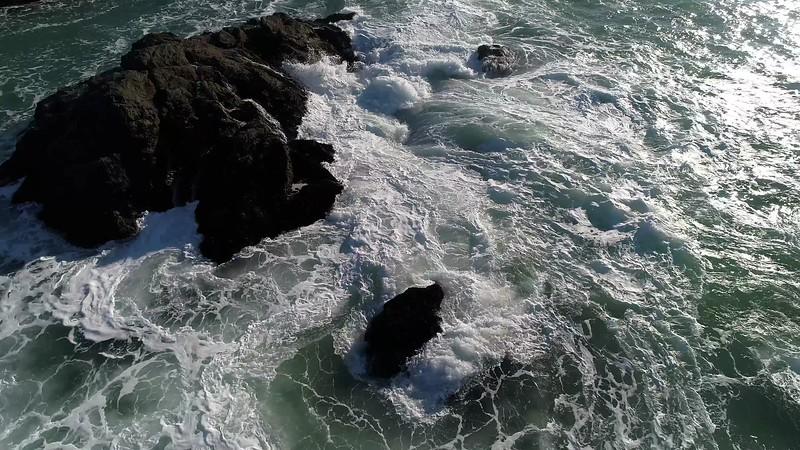 Ocean waves crashing over rocks