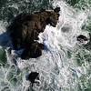 God's Eye View of Ocean Rocks with Swirling Ocean Water & Waves