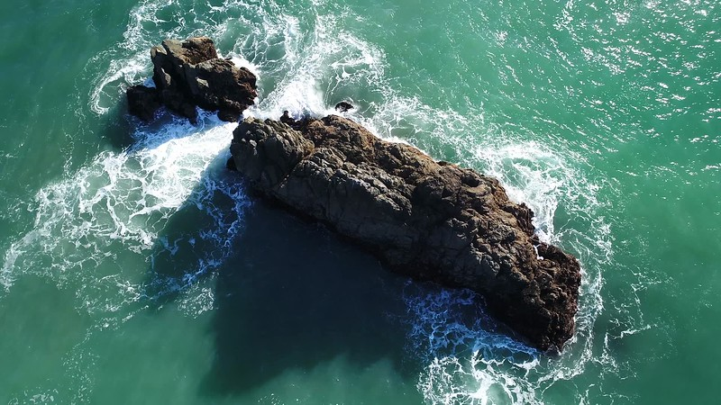 God's Eye View of Ocean Rock with Waves