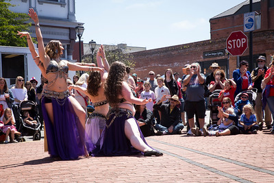 Belly dancers posed together as they finished their routine at Eureka Main Street's Fourth of July festival. (Sam Armanino - The Times-Standard)
