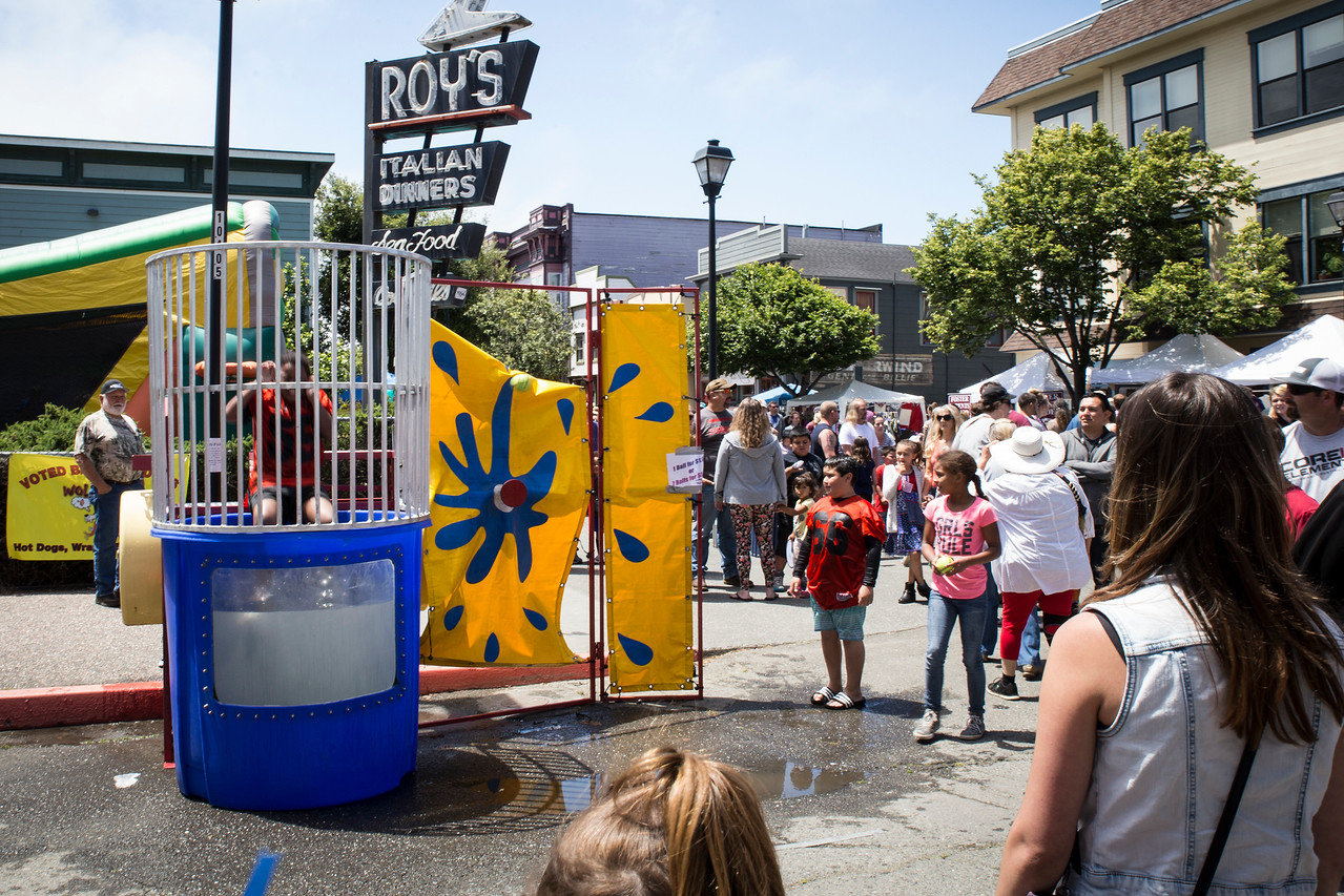 Arcata youth football members volunteered to be dunked in a water tank in order to raise money for their team during the Independence Day fun in Old Town on Tuesday. (Sam Armanino - The Times-Standard)