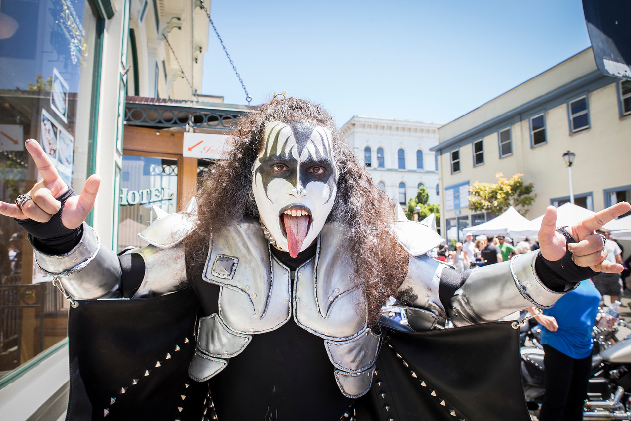 Gene Lemos poses as Gene Simmons from the rock band Kiss during the Fourth of July festival on Tuesday in Old Town.  (Sam Armanino - The Times-Standard)